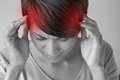 Woman suffers from pain headache sickness migraine stress insomnia hangover in casual dress two hands holding head Stock Image