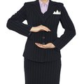 Woman in suit holding his hands before him Royalty Free Stock Photography
