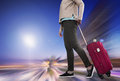 Woman with suitcase awaiting aircraft Royalty Free Stock Photo