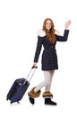 Woman with suitcase preparing for winter vacation Royalty Free Stock Images