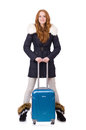 Woman with suitcase preparing for winter vacation Royalty Free Stock Image