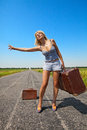 Woman with suitcase stops the car Stock Images