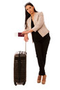 Woman with suitcase tired of waiting on airplane departure. Royalty Free Stock Photo