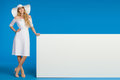 Woman In Summer Dress, Sun Hat And High Heels Is Posing With White Banner Royalty Free Stock Photo