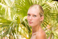 Woman at the summer lounge beautiful young tropical resort Royalty Free Stock Photo