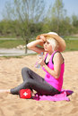 Woman with sun hat drinking water Royalty Free Stock Photo