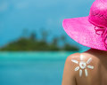 Woman with sun shaped sun cream maldives Stock Photography