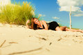 Woman sunbathing on beach summer vacation day freetime concept sitting body delight seaside Royalty Free Stock Images