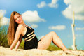 Woman sunbathing on beach summer vacation day freetime concept sitting body delight seaside Royalty Free Stock Photos