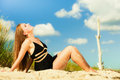 Woman sunbathing on beach summer vacation day freetime concept sitting body delight seaside Stock Photos