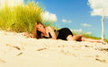 Woman sunbathing on beach summer vacation day freetime concept sitting body delight seaside Royalty Free Stock Photography