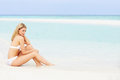 Woman sunbathing on beautiful beach holiday relaxing Royalty Free Stock Photo