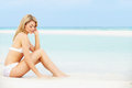 Woman sunbathing on beautiful beach holiday relaxing Royalty Free Stock Images