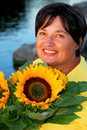 Woman sunflowers Stock Images
