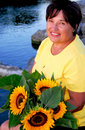 Woman sunflowers Stock Image