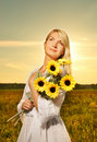 Woman with a sunflowers Stock Image