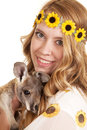 Woman sunflowers headband close baby kangaroo a with a smile on her face holding on to her Royalty Free Stock Photos