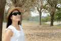 Woman with sunglass and hat portrait blurred of at park Royalty Free Stock Image