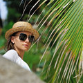 Woman in sunglasses near palm tree Stock Photography