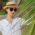 Woman in sunglasses near palm tree Royalty Free Stock Photography