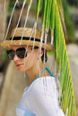 Woman in sunglasses near palm tree Stock Image