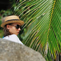 Woman in sunglasses near palm tree Royalty Free Stock Images