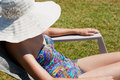 Woman sunning herself Stock Photography