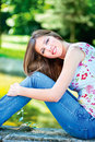 Woman on sunny day in park cute brunette outdoor Stock Photo