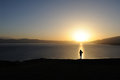 Woman at sunrise chinese standing on the lakeside Royalty Free Stock Image