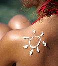 Woman with suntan lotion at the beach Royalty Free Stock Photo