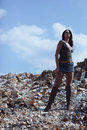 Woman with superior attitude young model superiority standing in field of crumbled rocks Stock Image