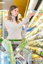 Woman at supermarket Royalty Free Stock Photo