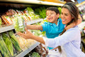 Woman at the supermarket with her son Stock Photos