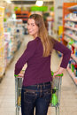 Woman in supermarket with shopping cart Stock Photo