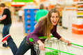 Woman in supermarket with shopping cart Royalty Free Stock Photo