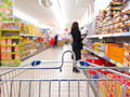 Woman at the supermarket with trolley shopping Stock Image