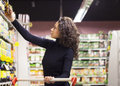 Woman in supermarket Royalty Free Stock Photo
