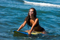Woman on surfboard girl in bikini sit in sea water Royalty Free Stock Images