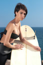 Woman with surfboard under blue sky stand Stock Photography
