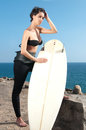 Woman with surfboard under blue sky stand Royalty Free Stock Photos
