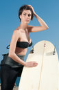 Woman with surfboard under blue sky stand Stock Image