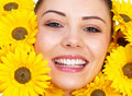 Woman Surrounded by flowers Stock Image