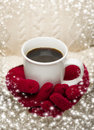 Woman in sweater with red mittens holding cup of coffee seasonal a warm snow flakes border Royalty Free Stock Photography