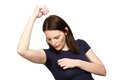 Woman sweating very badly under armpit in blue shirt Stock Photography