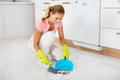 Woman Sweeping Floor With Broom And Dustpan Royalty Free Stock Photo