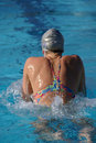Woman Swimming Breaststroke Stock Photography