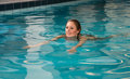Woman swimming forward crawl in public swimming pool Royalty Free Stock Photo