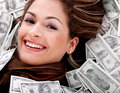 Woman swimming in money Royalty Free Stock Photo