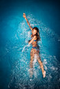 Woman swimming in pool Royalty Free Stock Images