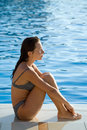 Woman by swimming pool Royalty Free Stock Photography